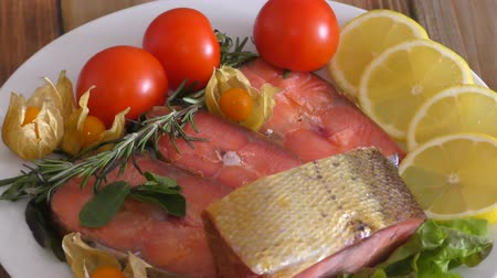 omega : Chinook salmon (LAT. Oncorhynchus tshawytscha) smoked with fresh Greens and vegetables Stock Footage