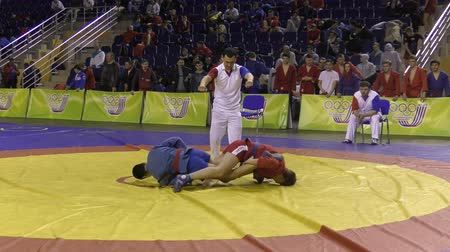 wrestler : Orenburg, Russia - October 29, 2016: Boys competitions Self-defense without weapons in the Championship of Russia in Self-defense without weapons among boys and girls born 2000-2001 biennium of birth