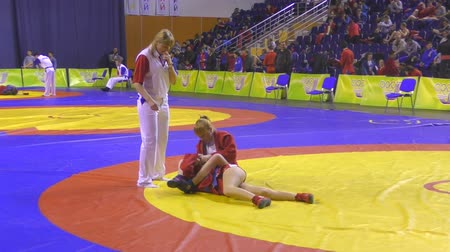 wrestler : Orenburg, Russia - October 29, 2016: Girls in the self-defense without weapons among the boys and girls born 2000-2001 biennium of birth