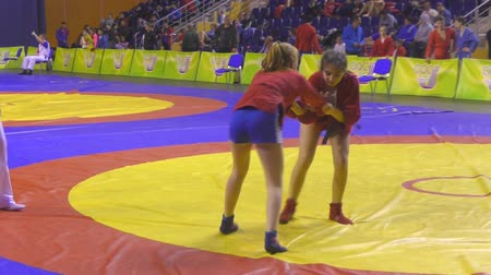 grappling : Orenburg, Russia - October 29, 2016: Girls in the self-defense without weapons among the boys and girls born 2000-2001 biennium of birth