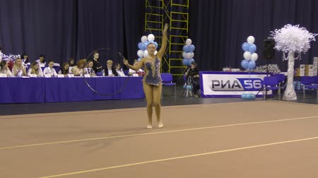 ritmikus : Orenburg, Russia - November 25, 2017 year: girl performing exercises with gymnastic hoop in rhythmic gymnastics on the Championship Orenburg region on rhythmic gymnastics Winter melody-2017.