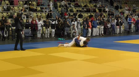 chutando : Orenburg, Russia - 5 February 2016: boys compete in judo at the Championship of the Orenburg region