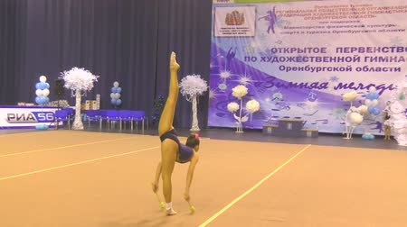 gracefully : Orenburg, Russia - November 25, 2017 year: girls compete in rhythmic gymnastics perform exercises with sports clubs on the Championship Orenburg region on rhythmic gymnastics Winter melody-2017
