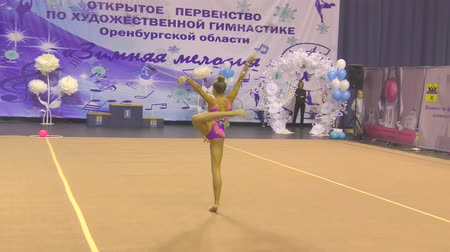 acrobats : Orenburg, Russia - November 25, 2017 year: girls compete in rhythmic gymnastics perform exercises with sports clubs on the Championship Orenburg region on rhythmic gymnastics Winter melody-2017