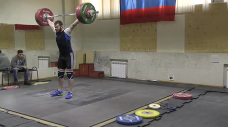 biceps : Orenburg, Russia, December 17, 2017 years: the boys compete in weightlifting for the Cup and Championship weightlifting area Stock Footage