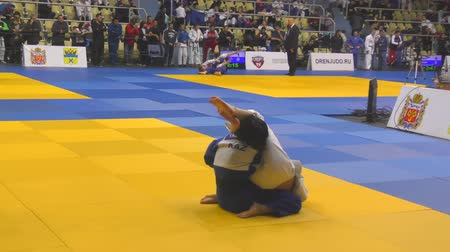tekmeleme : Orenburg, Russia - 21 October 2017: Girls compete in Judo at the all-Russian Judo tournament among boys and girls dedicated to the memory of VS Chernomyrdin