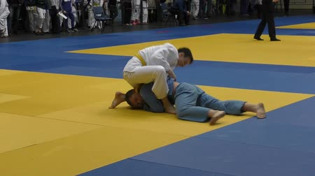 combativo : Orenburg, Russia - 5 February 2016: boys compete in judo at the Championship of the Orenburg region