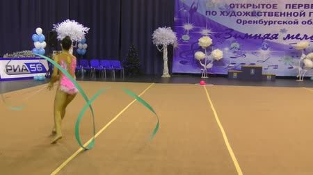 ritmikus : Orenburg, Russia - November 25, 2017 year: girls compete in rhythmic gymnastics for the winter melody-2017. Stock mozgókép