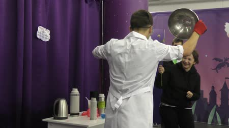 banka : Orenburg, Russia - September 29, 2019: Man shows experience with liquid nitrogen