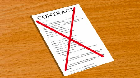 cancellation : Two red lines cross out the contract that is on the table Stock Footage