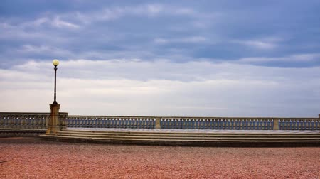 xadrez : Panoramic view of Terrazza Mascagni (Mascagni terrace) in front of the Ligurian sea on the western coast of Tuscany in Livorno Vídeos