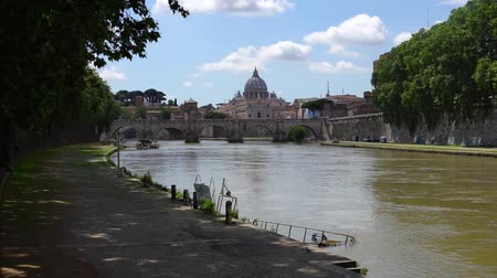 Vatican dome of Saint Peter Basilica (Italian: San Pietro) and SantAngelo Bridge, over Tiber river, Rome, Italy Stock Footage