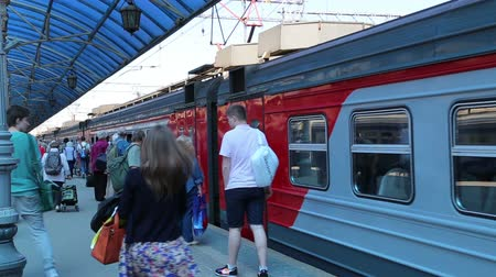platforma : Passengers on Moscow passenger platform Yaroslavsky railway station, Russia-- is one of nine main railway stations in Moscow, situated on Komsomolskaya Square. It has highest passenger throughput of all nine Moscow stations