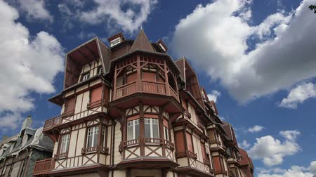 normandie : Stylized half-timbered house. Etretat, France. Etretat is a commune in the Seine-Maritime department in Haute-Normandie region in northwestern France.Etretat is now a famous French seaside resor Stock Footage