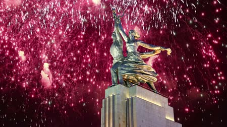 socialist party : Famous soviet monument Rabochiy i Kolkhoznitsa (Worker and Kolkhoz Woman or Worker and Collective Farmer) of sculptor Vera Mukhina and fireworks, Moscow, Russia. Made of in 1937 Stock Footage
