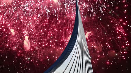conquerors : Conquerors of Space Monument in the park outdoors of Cosmonautics museum and fireworks, near VDNK exhibition center, Moscow, Russia