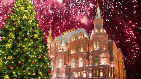 state capital : Fireworks over the State Historical Museum (inscription in Russian), near the Kremlin in Moscow, Russia Stock Footage