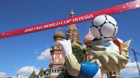moscow : Official symbols of the 2018 FIFA World Cup in Russia (against the background of Moscow landmarks) Stock Footage