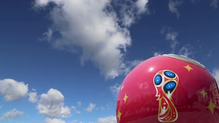 фэн : Official symbols of the 2018 FIFA World Cup in Russia (against the sky with clouds) Стоковые видеозаписи