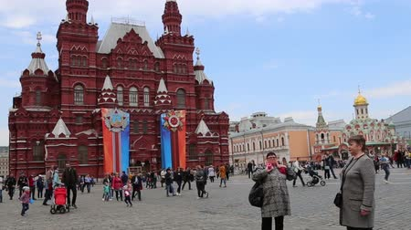state capital : State Historical Museum (Victory Day decoration). Red Square, Moscow, Russia Stock Footage