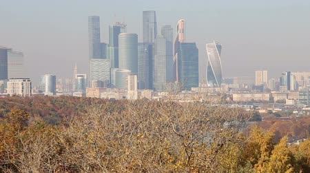 gory : The Moscow City from Sparrow Hills or Vorobyovy Gory Observation Platform is a bank of 85 m above the Moskva River, or 200 m above sea level. Moscow, Russia Stock Footage