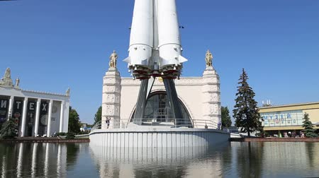 former : Spaceship Vostok (monument to the first Soviet rocket) shown at VDNKH park in Moscow, Russia. VDNH is a large city park, exhibition center and amusement park, popular touristic landmark Stock Footage