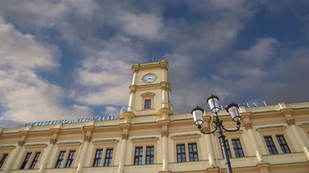 devět : Historic building of the Leningradsky railway station (on the background of moving clouds) - is one of the nine main railway stations of Moscow, Russia