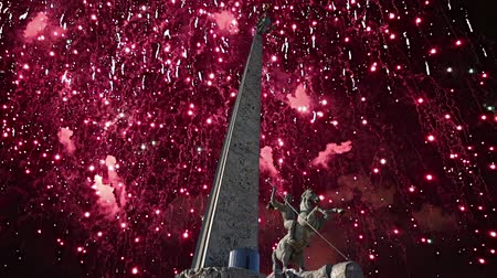 obelisk : Fireworks over the War memorial in Victory Park on Poklonnaya Hill (Gora), Moscow, Russia. Stock Footage