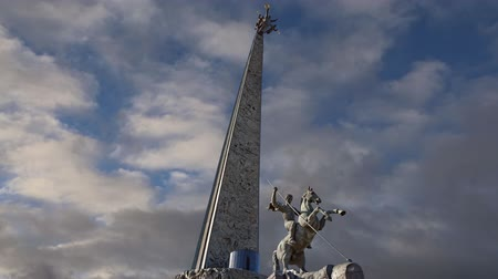 obeliszk : War memorial in Victory Park on Poklonnaya Hill (on the background of moving clouds), Moscow, Russia. Stock mozgókép