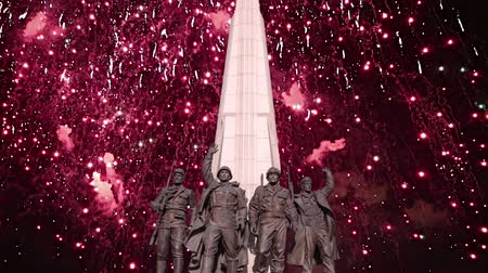 obelisk : Fireworks over the Monument The tragedy of peoples in Victory Park on Poklonnaya Hill (Gora), Moscow, Russia-- established in memory of the victims of the fascist genocide Stock Footage