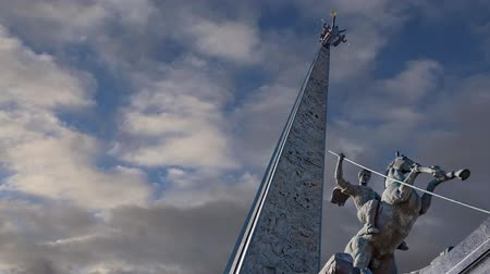 obelisco : Monument to Saint George slaying a dragon (on the background of moving clouds) on Poklonnaya hill in Victory Park, Moscow, Russia - memorial complex constructed in memory of those who died during the Great Patriotic war