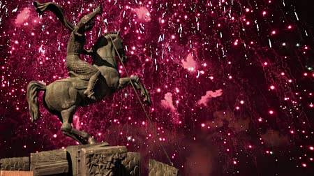 追悼 : Fireworks over the Monument to Saint George slaying a dragon on Poklonnaya hill in Victory Park, Moscow, Russia - memorial complex constructed in memory of those who died during the Great Patriotic wa