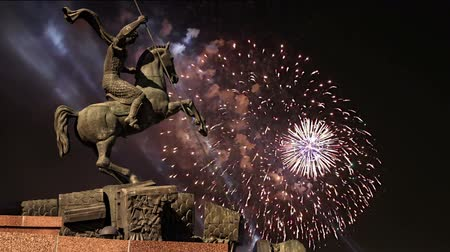 obelisk : Fireworks over the Monument to Saint George slaying a dragon on Poklonnaya hill in Victory Park, Moscow, Russia - memorial complex constructed in memory of those who died during the Great Patriotic war