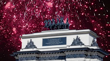 追悼 : Fireworks over the Triumphal arch on Kutuzov Avenue in Moscow, Russia. This Triumphal Arch was built in honor of the memory of the great Russian victory in 1814 ... ?inscription in Russian. reconstruc 動画素材