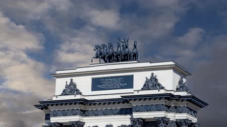 alexander column : Triumphal arch (on the background of moving clouds) on Kutuzov Avenue in Moscow, Russia. This Triumphal Arch was built in honor of the memory of the great Russian victory in 1814 ... ?inscription in Russian. reconstructed here in 1968
