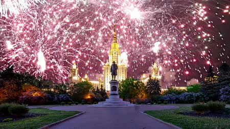 fireworks : Fireworks over the main building of the Moscow State University on Sparrow Hills, Russia Stock Footage