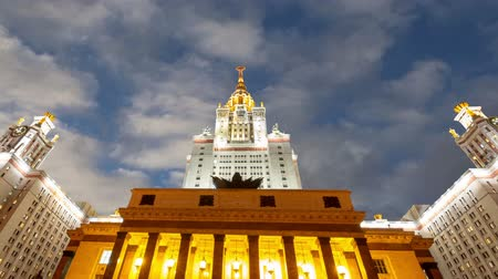 main : Main building of the Moscow State University on Sparrow Hills (on the background of moving clouds), Russia