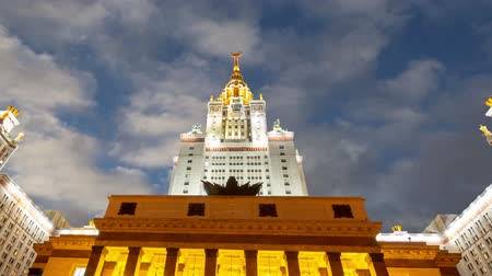 veréb : Main building of the Moscow State University on Sparrow Hills (on the background of moving clouds), Russia
