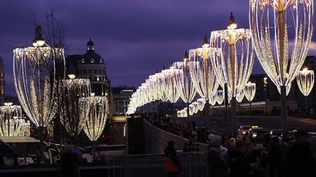 Christmas (New Year holidays) decoration in Moscow (at night), Russia-- Bolshoy Moskvoretsky bridge. Journey to Christmas, Moscow seasons. View from Zaryadye Park. Stock mozgókép