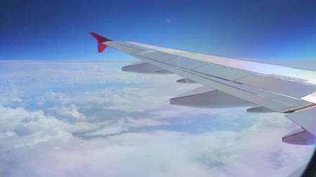 airplane engine : The view from an airplane window - Wing of an airplane flying