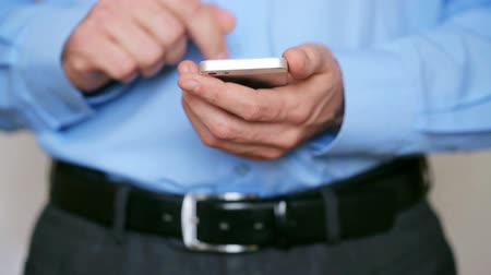 КПК : Businessman using smartphone for text messaging