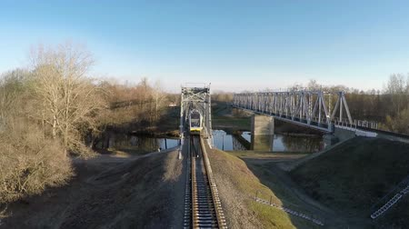 modern train wagon : Passenger train goes over the bridge, filming from the top Stock Footage