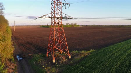 field survey : Aerial survey flying over the power lines at sunset Stock Footage