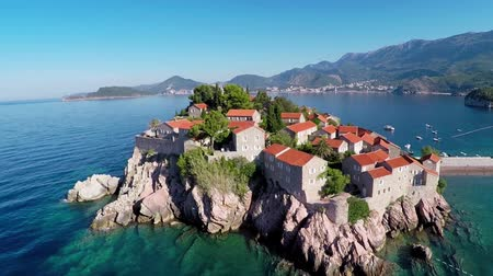 vacation destination : Flying over the island of Sveti Stefan, Montenegro, the Balkans - aerial photography