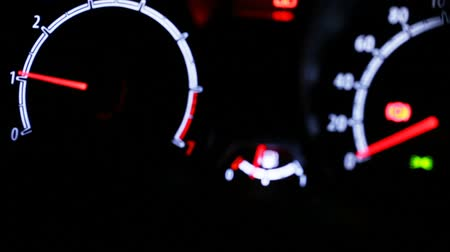 mph : Car instrument panel illuminated at night