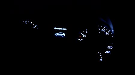 mph : Car instrument panel illuminated in dark Stock Footage