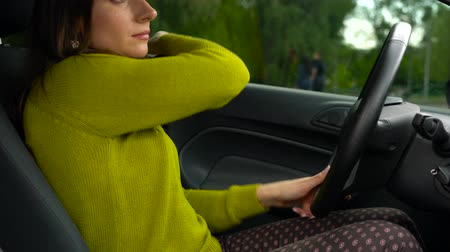 přezka : Woman fastening car safety seat belt while sitting inside of vehicle before driving