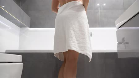 getting ready : Woman entering the shower and dropping her towel