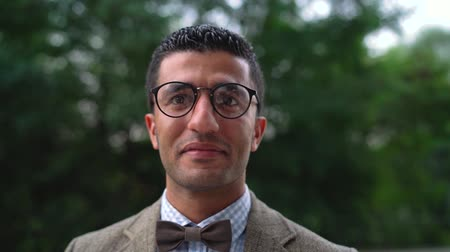 kravata : Portrait of a young Arab smiling man in glasses