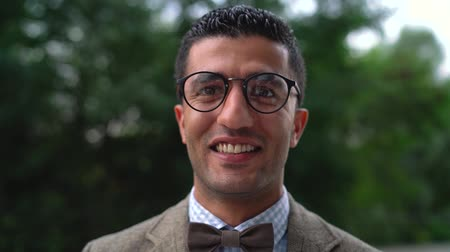 szerény : Portrait of a young Arab smiling man in glasses